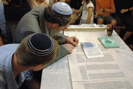 The Sofer writes the last words of the new Tora scroll