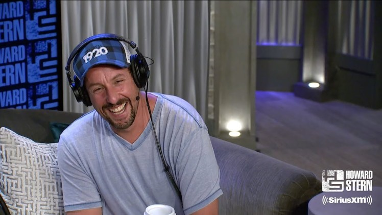 Adam Sandler and Howard Stern recite the blessing on the Torah.