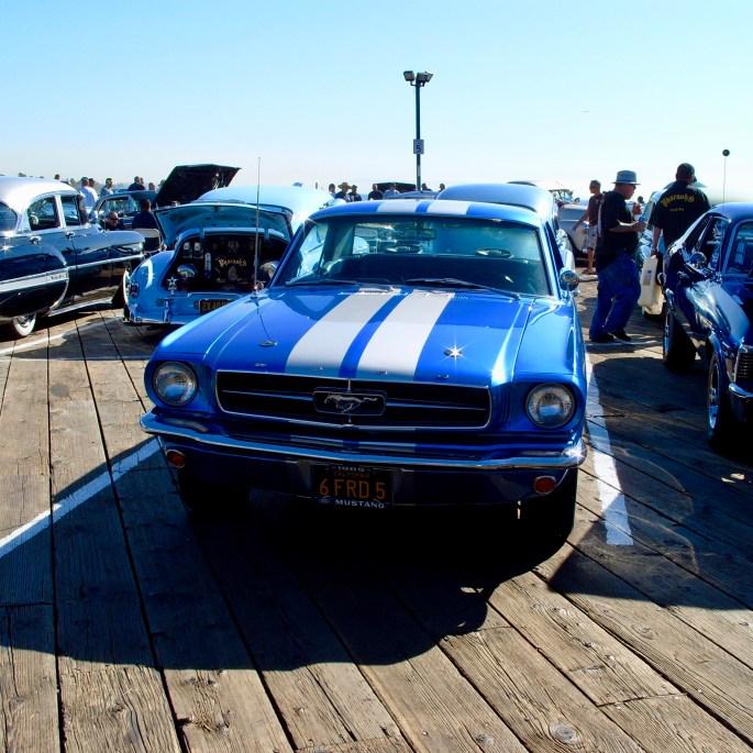 Blue Ford Mustang at Santa Monica Pier, CA by Jez Braithwaite