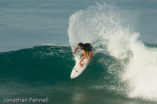 Surfer doing a backside snap