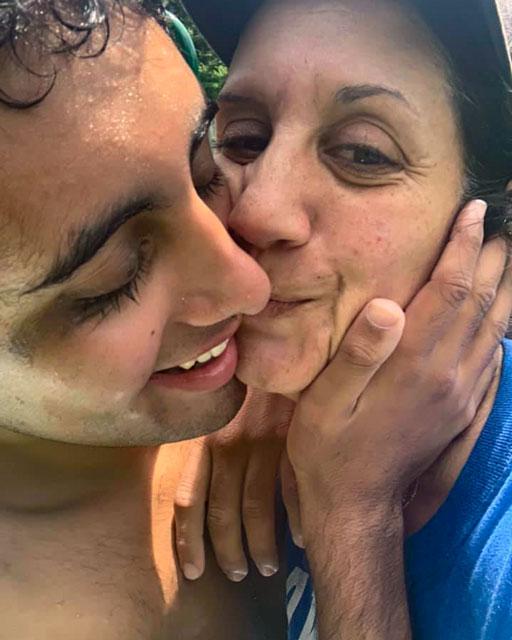 Aiden kissing mom