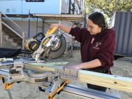 Whittier senior Siarra Cronin, of Haverhill, uses a saw while helping to build a home through Merrimack Valley Habitat for Humanity. (Courtesy Photo Whittier Tech)