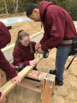Seniors Tyler Wetherbee, right, and Emily Wilson are members of a group of 12 Whittier carpentry students using their skills to help build homes with Merrimack Valley Habitat for Humanity this school year. (Courtesy Photo Whittier Tech)