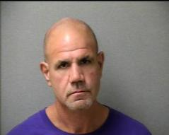 STEPHEN DELONG, AGE 53, of LAWRENCE is accused of being the getaway driver and lying to investigators. DELONG is charged with Armed Robbery as a Joint Venture and Misleading a Police Investigation. (Chelmsford Police Booking Photo)