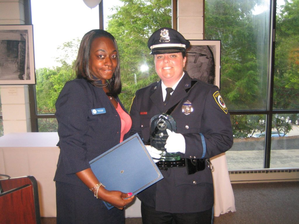 """Officer Kelley Tobyne receives the 2015 """"Spirit of MAWLE"""" Award for Community Service."""