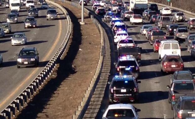 A row of police cars on its way from Burlington (Bedford Police Photo)