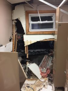 A view of the interior damage with the truck's grille visible in black. (Dracut Police Department/Courtesy Photo)