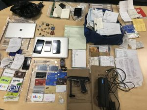 Officers conducting an on-scene investigation during a traffic stop located a silver and black BB gun, dozens of credit cards, a credit card reader and fraudulent driver's licenses in a vehicle. A 27-year-old Woburn man was arrested.