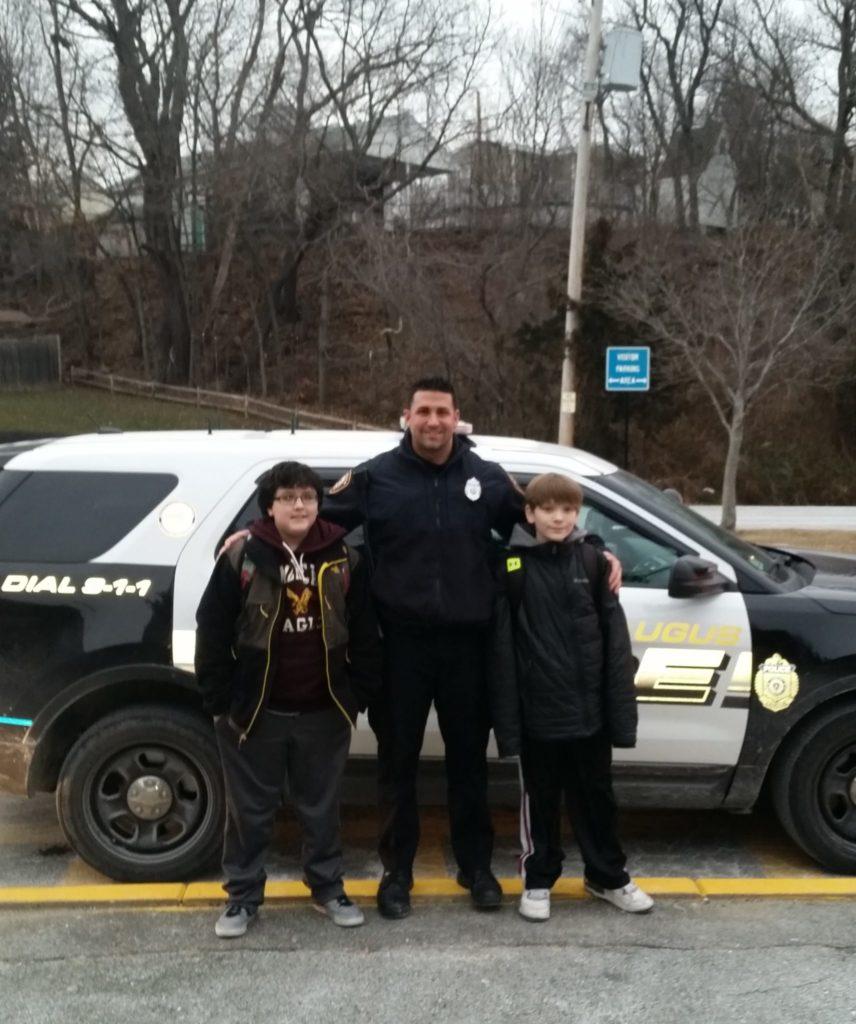 Pictured below, left to right, are Devon Burke, Officer Lorenzo Internicola and Logan Rau. (Courtesy Photo)