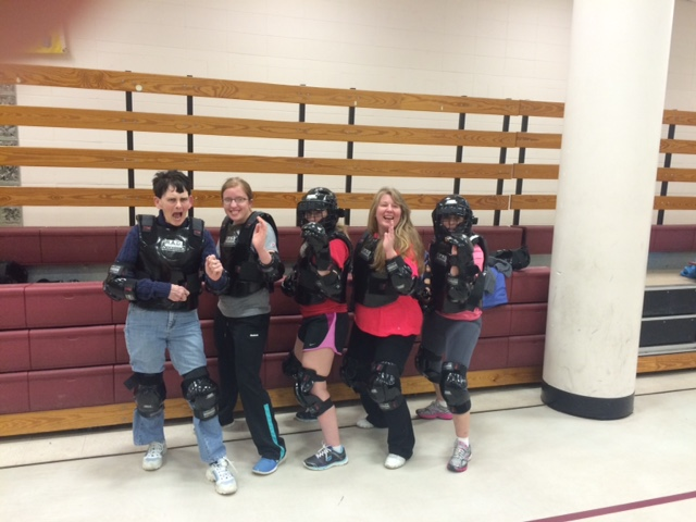 Participants in protective gear, ready to practice their defense skills at Dunstable's R.A.D. class in March.