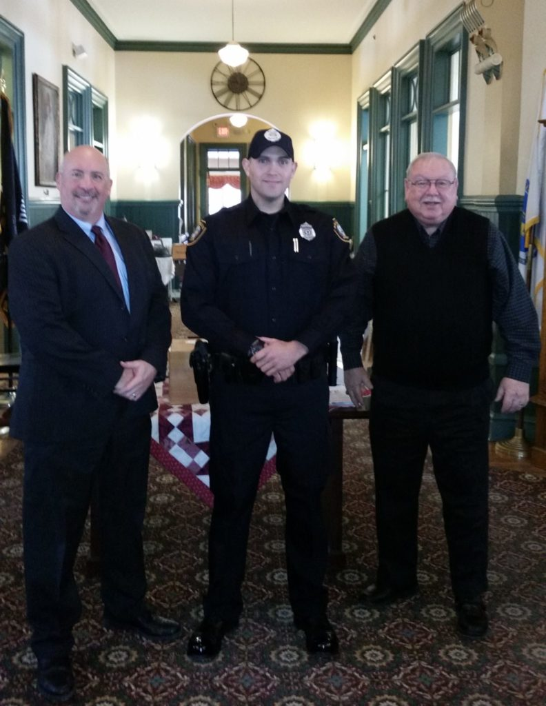 Pictured left-to-right: Saugus Police Chief Domenic J. DiMella, Officer Derek Ryan, and Acting Saugus Town Manager Robert Palleschi. (Courtesy of the Saugus Police Department)