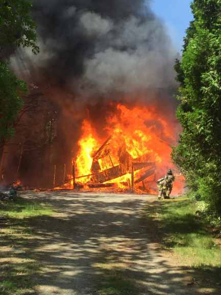 The Groton Fire Department extinguished a five-alarm garage and brush fire today (Courtesy Photo).