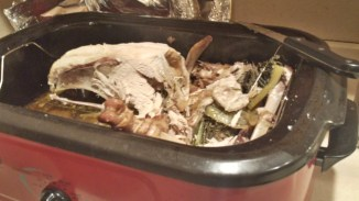 A carved turkey sits in the roasting pan.
