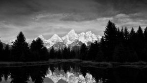 Storm clouds gather at dawn over the Teton range. Scene from Schwabacher Landing