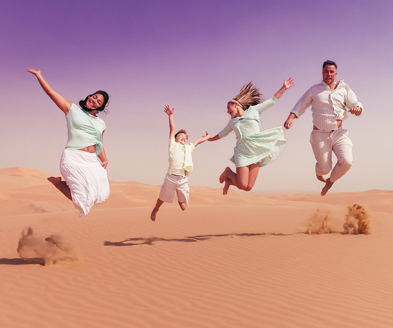 Family jumping in the desert sand photograph by Clarksville Photographer