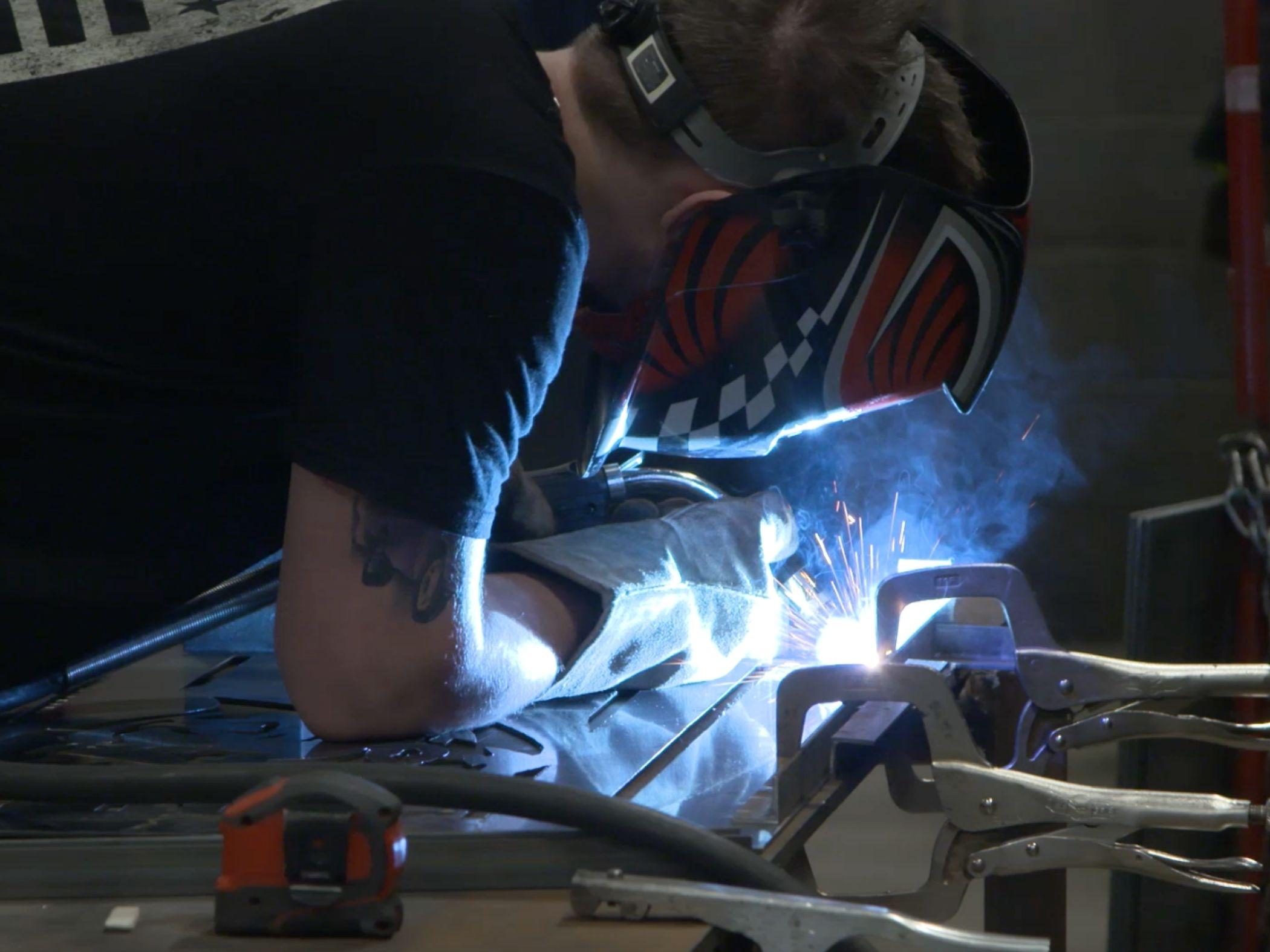 student welding in class