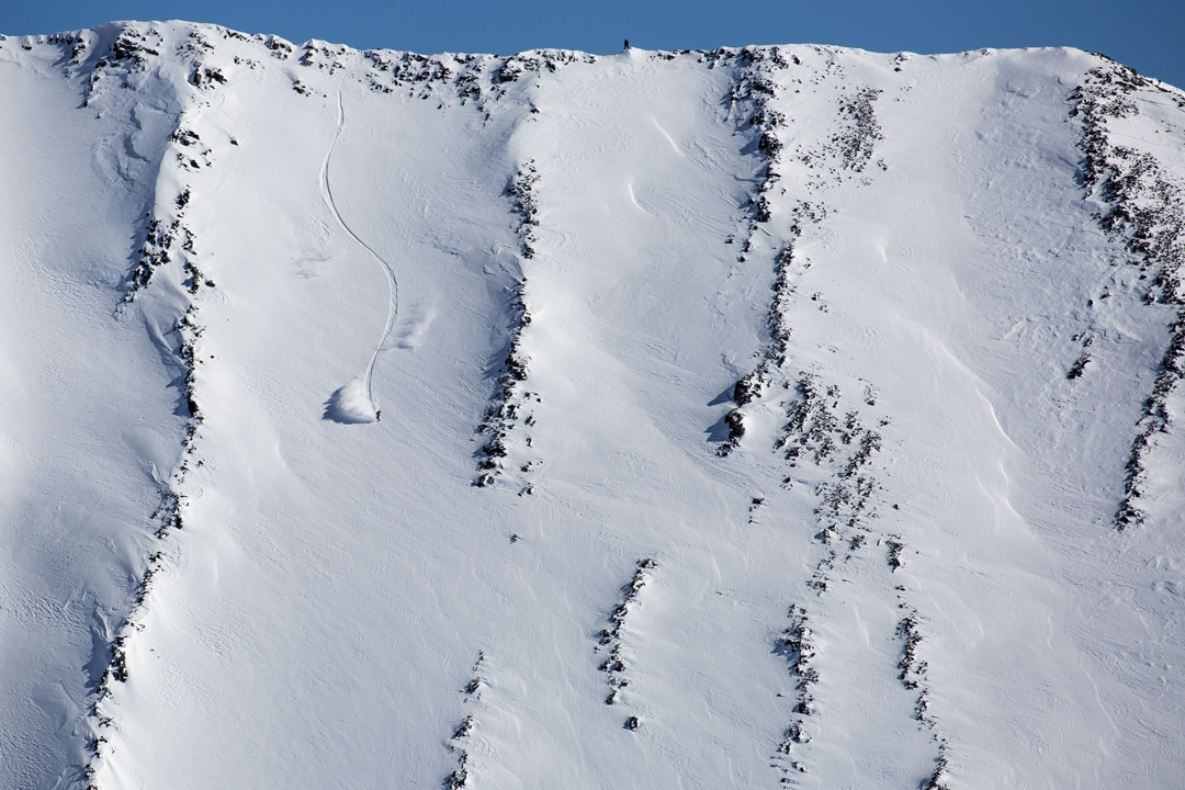 Snowboarding. 18-19 JHSM. Rider Robin Van Gyn riding in the Crazy Mountains of Montana. Photo: Ben Gavelda.