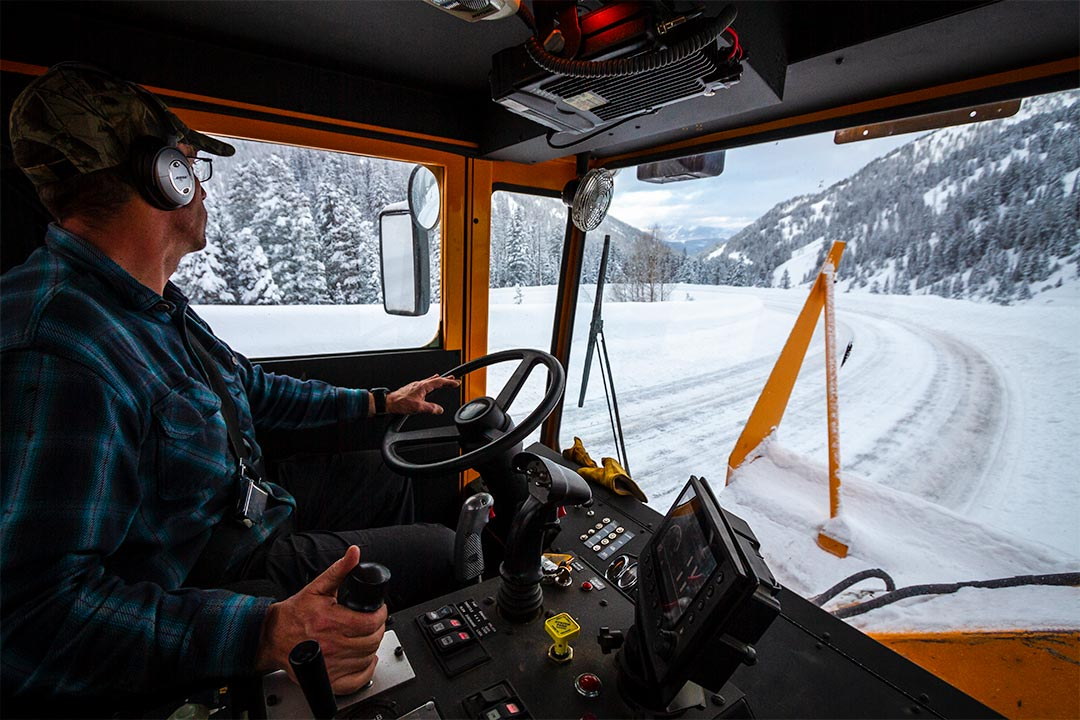 Glimpse inside a plow truck driving down the pass.
