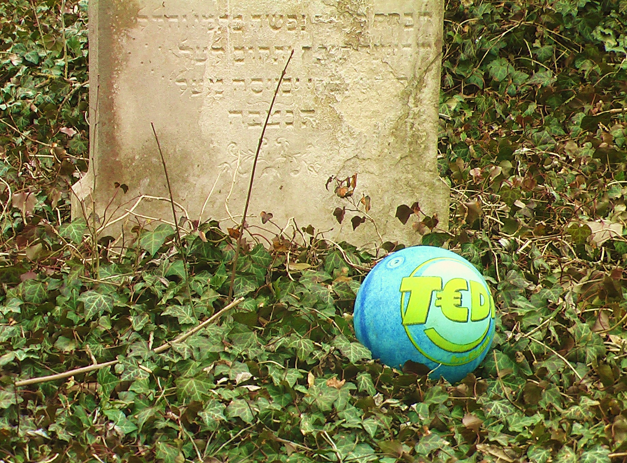 Hebrew grave marker with football