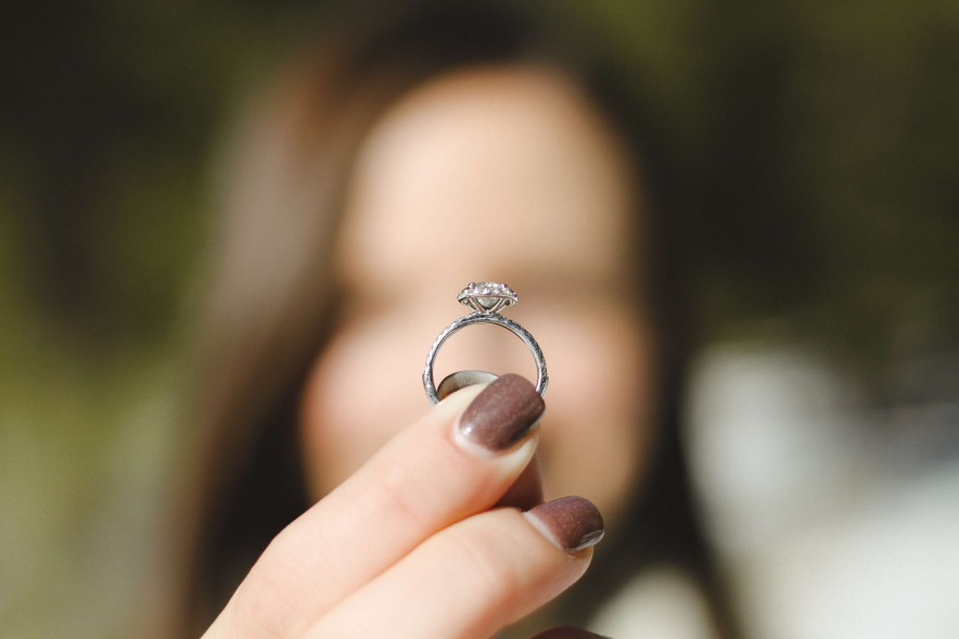 woman holding engagement ring