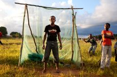 Children use a goal made from branches and old mosquito net in Mueda, Mozambique, in April 2011. Fernando Moleres/Panos