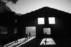 Children play soccer in the ruins of a house destroyed during the 1990s civil war in Kabul, Afghanistan, October 2010. Hossein Fatemi/Panos