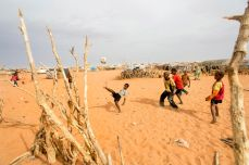 Children play soccer in the M'Berra camp for Malian refugees in Mauritania, March 2013. Nyani Quarmyne/Panos