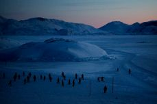 A small group of villagers from Aappilattoq, Greenland meet for a soccer game on the ice in the afternoon outside their village, in February 2008. Andrea Gjestvang/Panos
