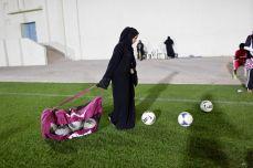 Qatari girls and women prepare to play soccer on the grounds of the Omar Bin Khatab Boys school in Doha, Qatar, in February 2014. Isabelle Eshraghi/Agence VU
