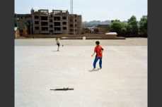Kids play soccer in the town center in Taijiang, Guizhou Province, China, in 2007. John Francis Peters