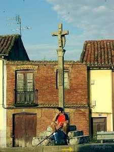 Pilgrim under a Roadside Cross, Mansilla de las Mulas, Spain by photographer Jill K H Geoffrion