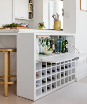 Wine bar tucked into the side of the kitchen island