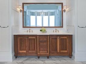 Walnut master ensuite vanity and custom mirror