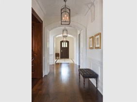 Front Hall with oak floors and traditional painted paneling