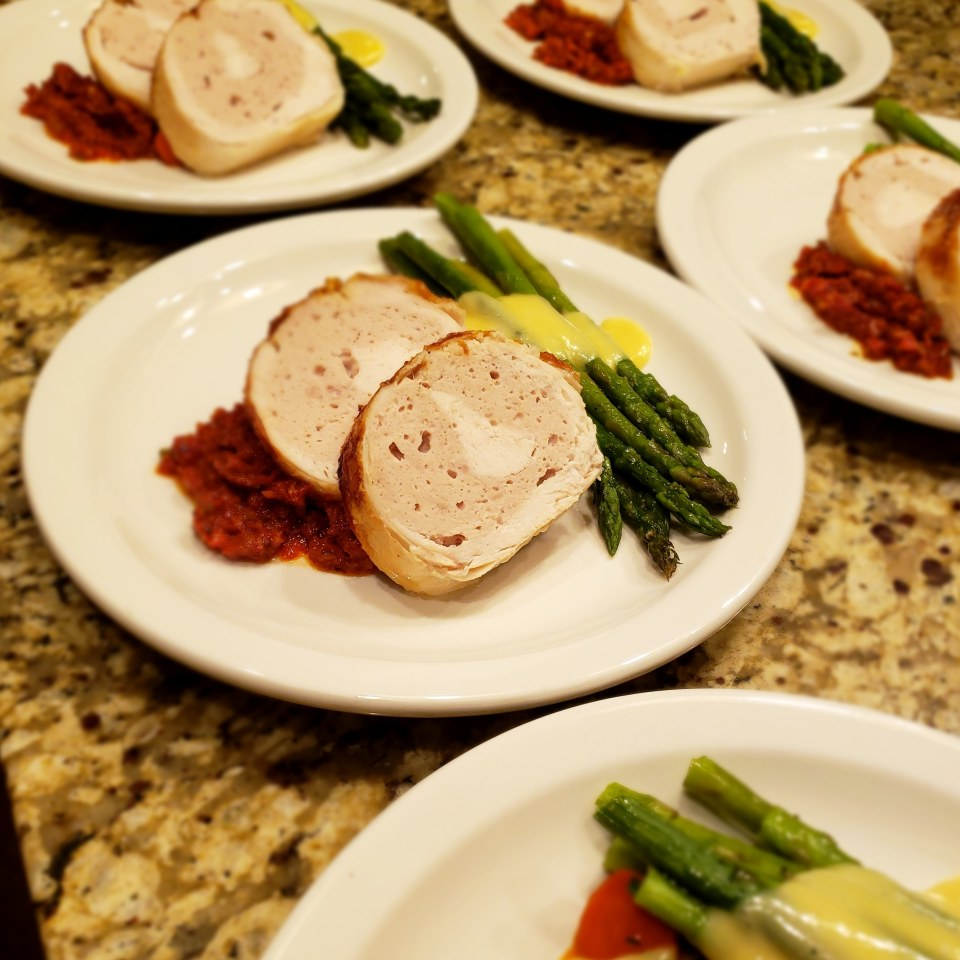 Chicken Roulade with sun dried tomato relish, asparagus, and hollandaise