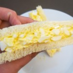Fluffy Egg Salad Sandwich in Hand