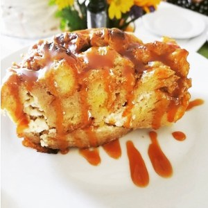 Mascarpone Stuffed French Toast Bread Pudding on a plate with caramel sauce drizzled over