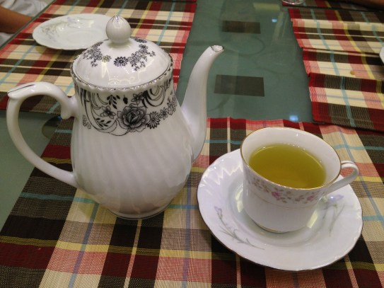 Discussion over tea & china