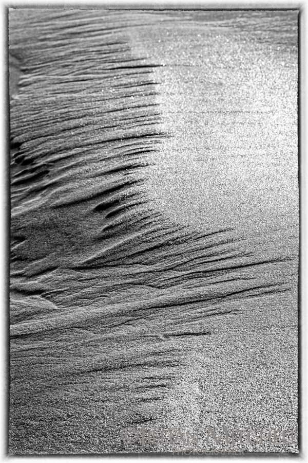 Abstract sand patterns on the beach.