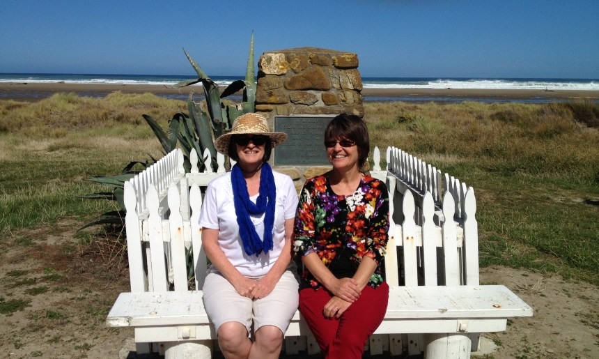 Me and my sister, posing nicely, in front of the memorial to the Herberts