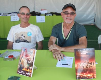 "Jim Arnold (r) signing ""The Forest Dark"" at the Palm Springs Pride Author's Village, here with fellow author Alan Chin."