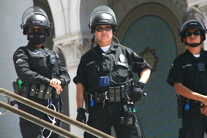 A line of police officers forms a barrier at L.A. City Hall in downtown Los Angeles