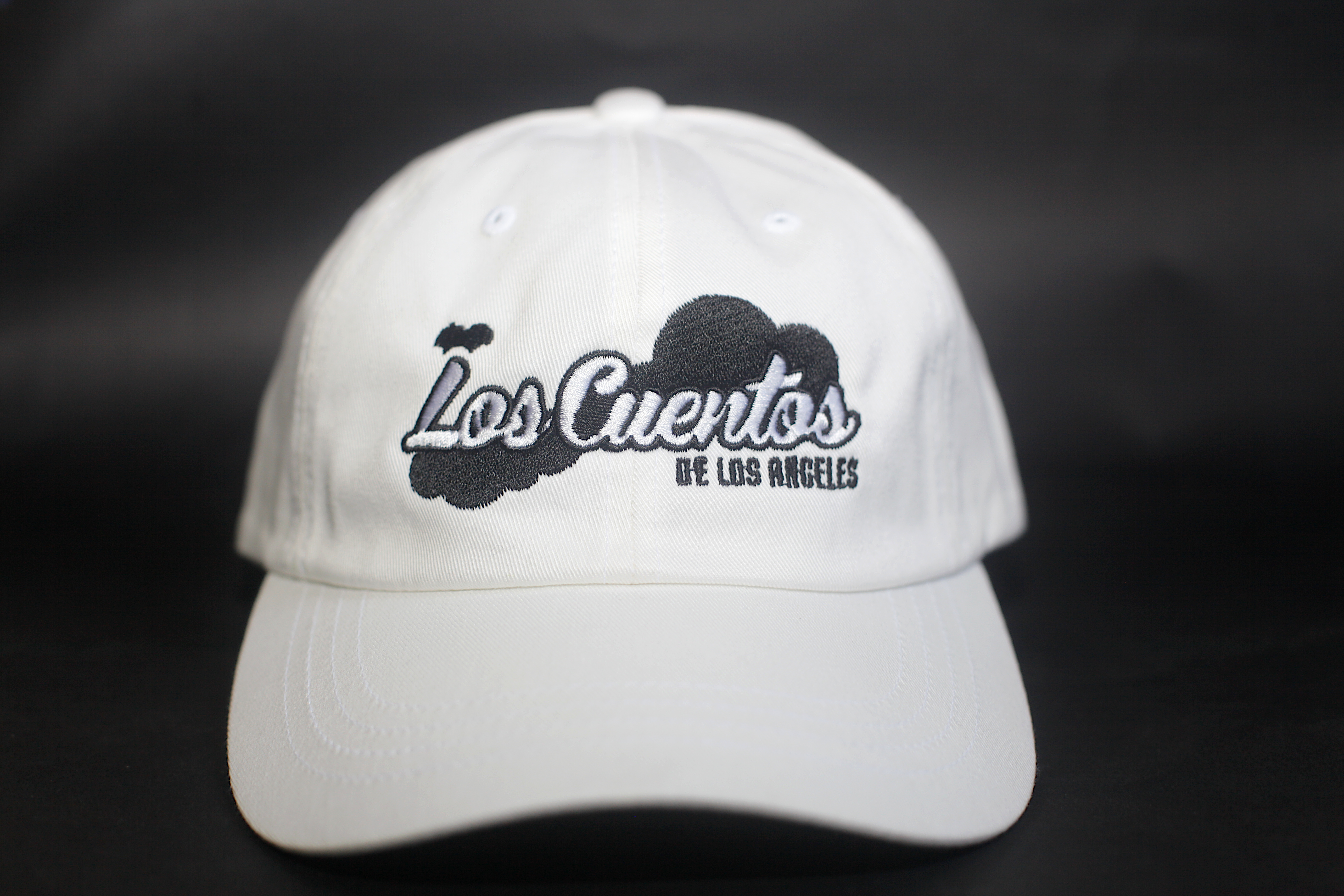 A white Los Cuentos hat with Black lining and stiching for Los Cuentos
