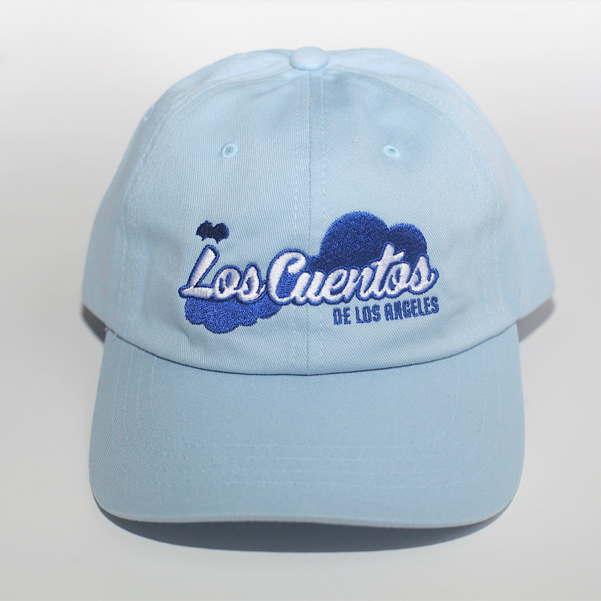 A Sky-blue Los Cuentos hat with navy blue lining and stiching for Los Cuentos