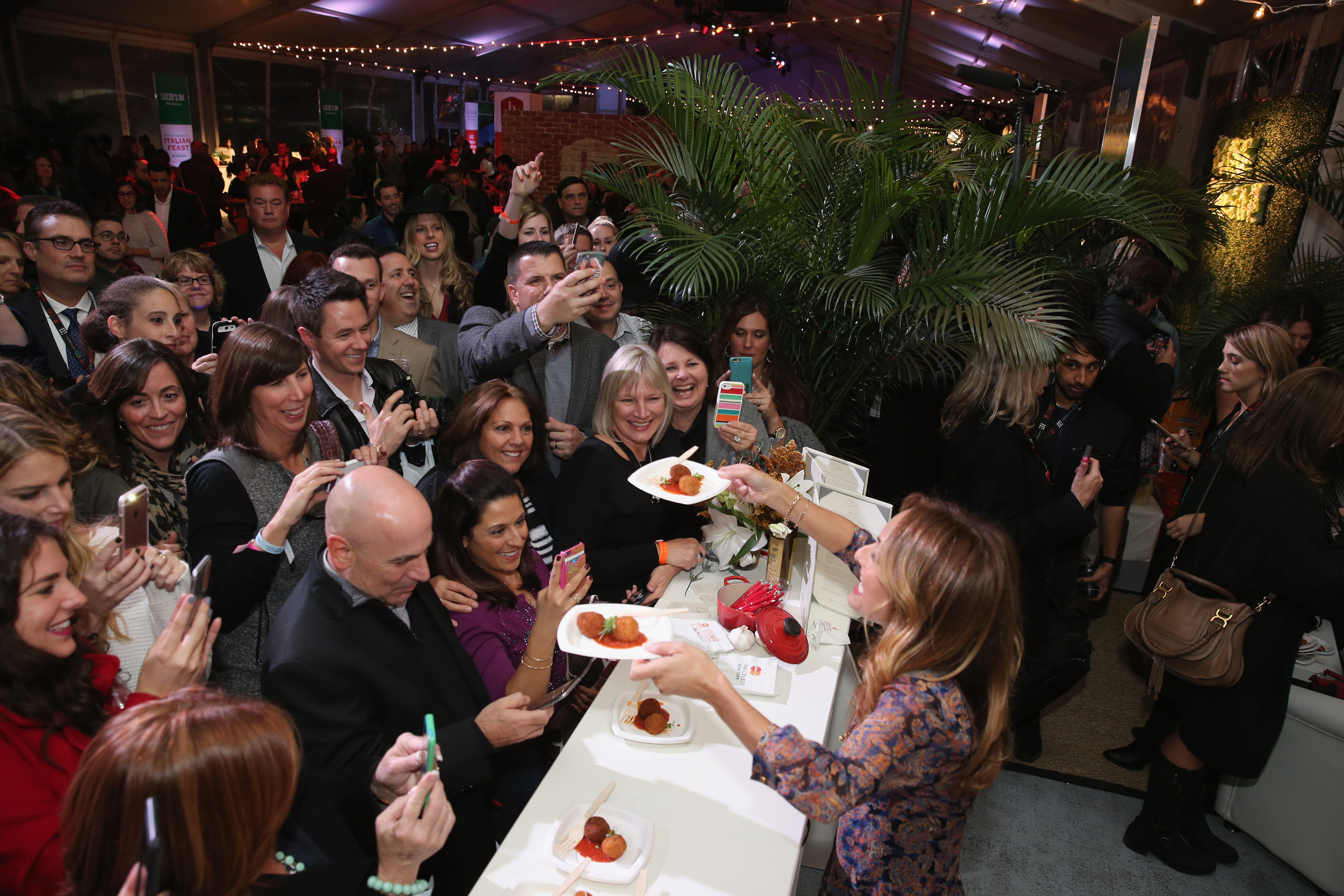 NEW YORK, NY - OCTOBER 15:  Chef Giada De Laurentis greets guests with food at Giada De Laurentiis' Italian Feast presented by Ronzoni sponsored by The New York Post during Food Network & Cooking Channel New York City Wine & Food Festival presented By FOOD & WINE at Pier 92 on October 15, 2015 in New York City.  (Photo by Neilson Barnard/Getty Images for NYCWFF)