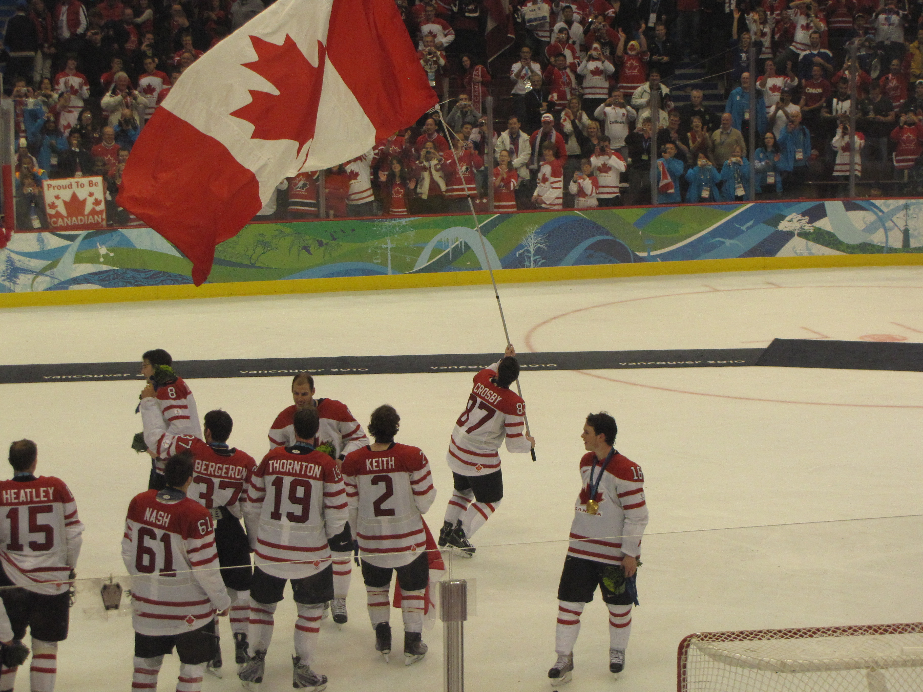 bbedd54a2 HOCKEY. Sid the Kid carries the Canadian flag after giving Canada the win  at the Vancouver Olympics in 2010. – JIM BYERS PHOTO