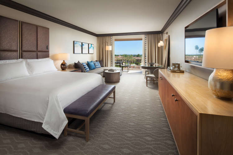 Guest rooms at The Phoenician are luxurious but comfortable, with soft tones reminiscent of the desert.