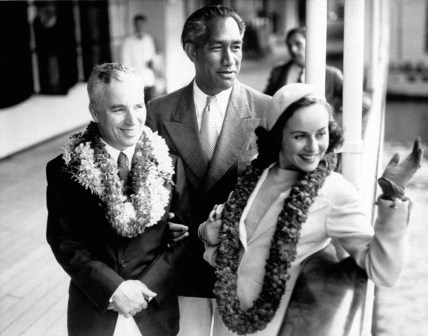 Duke greets Mr. and Mrs. Charlie Chaplin, 1938