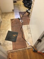 """Removing vinyl to reveal 1/4"""" plywood over original floor"""