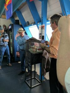 An emotional ceremony, the unveiling of the Twin Arrows Trading Post model created by Willem Bor at Antares Point Route 66 Visitor Center. Photo Sam Fiorella.